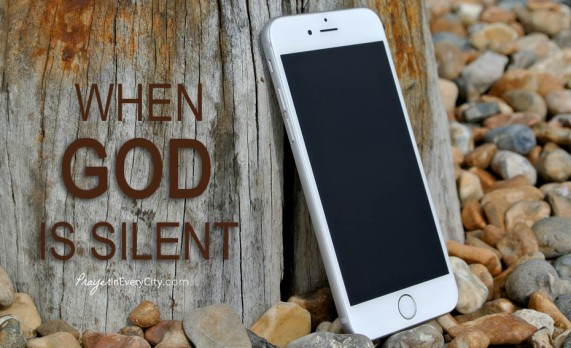 When god is Silent, cellphone leaning against tree